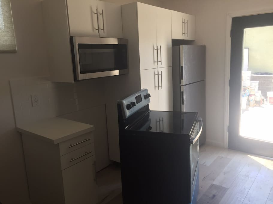 Almost finished Kitchen with Full size appliances, all Brand New, stainless, and lots of storage in the Kitchen cabinets