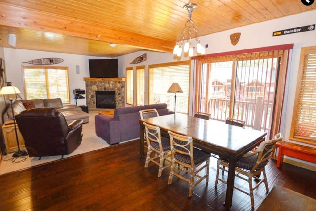 Open floor plan with tongue & groove wood ceiling & wood floor in entry & kitchen