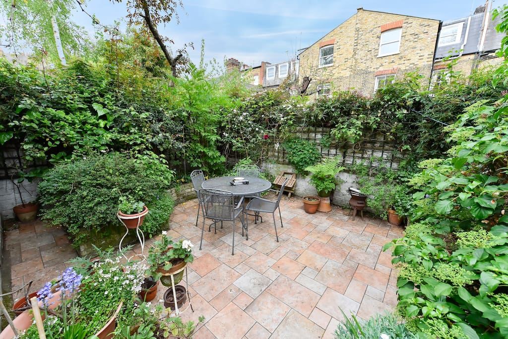 This wonderful flat has a lovely outside garden area with table, chairs and beautiful flowers.