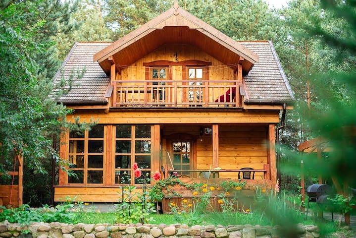 Dom na Mazurach puszcza jezioro pomost rower wodny