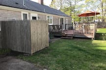 Outdoor shower enclosure and deck beyond