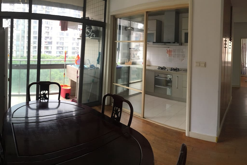 Kitchen, dining area, second balcony.