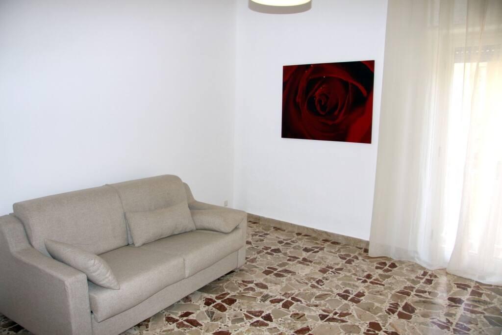 Camera da letto con divano letto matrimoniale