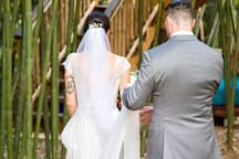 The bride and groom head to the treehouse stairs