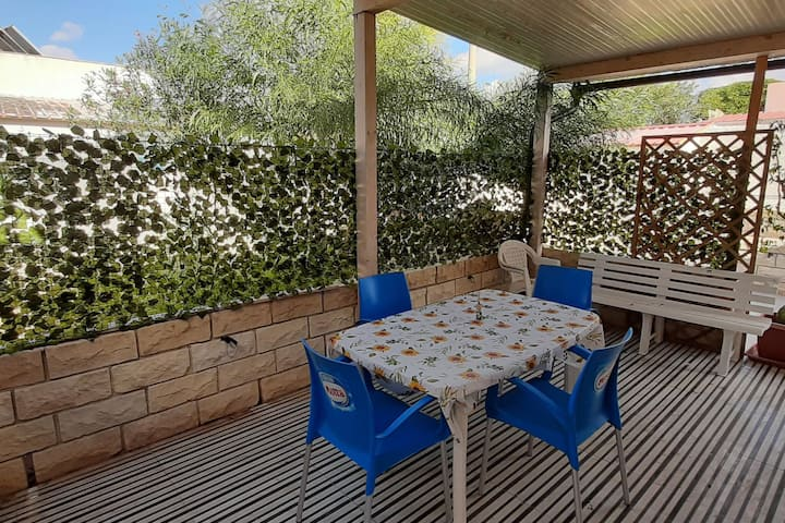 Snug Holiday Home in Porto Palo with Garden