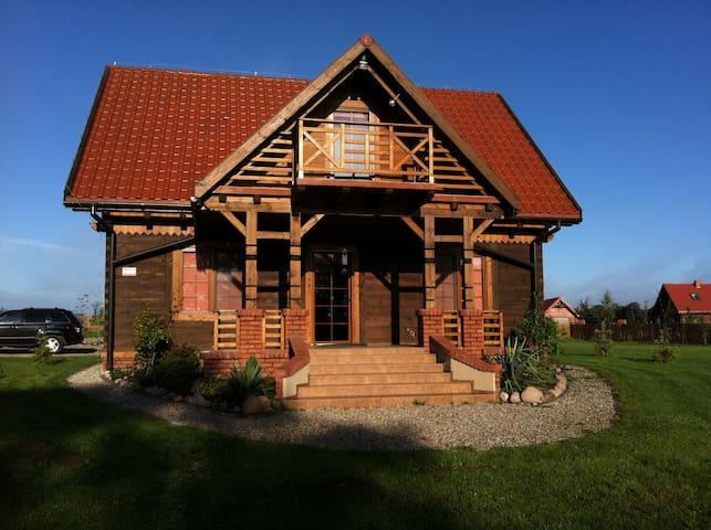 """""""Dom wśród malw"""" Mazury, jezioro, własny pomost."""