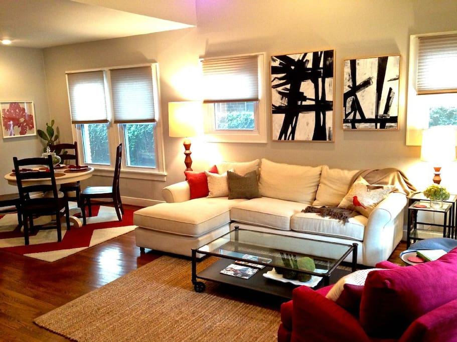 Bright and spacious living area. The comfortable sofa faces a 70-inch HDTV.