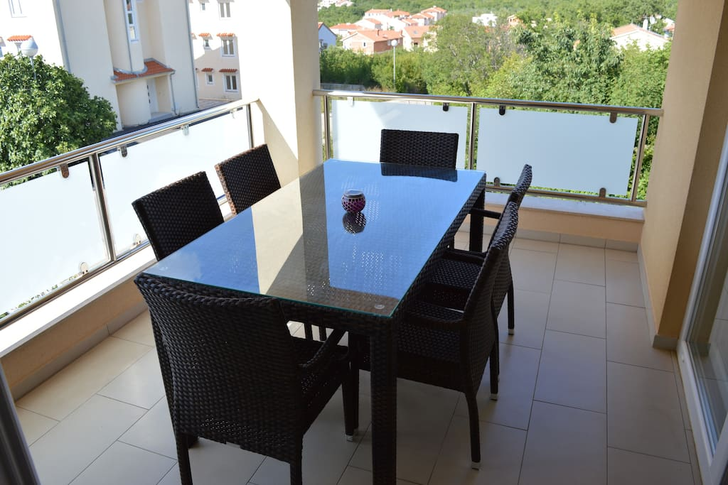 Large balcony with 6 people dining table