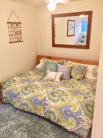 Comfortable queen bed to sleep in after a long day at the beach.
