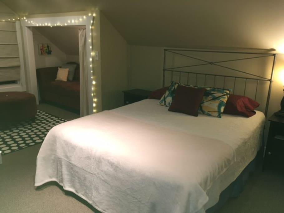 Bedroom includes queen bed and queen futon.