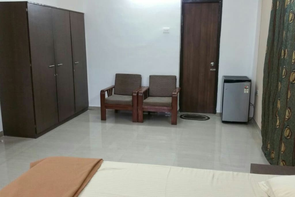 Big size rooms with TV, fridge, beds, cupboards, sofa chairs