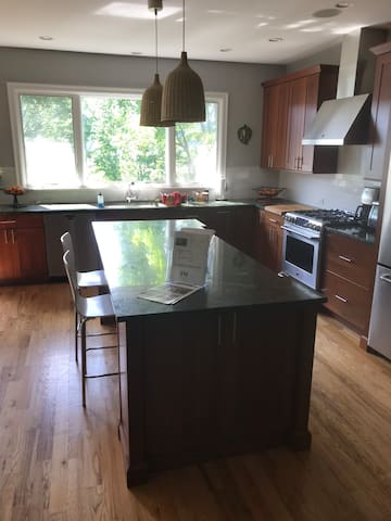 2 bedroom with access to dining, kitchen and deck
