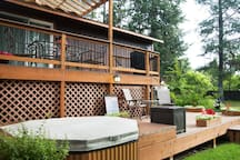 Lower deck with shared hot tub.