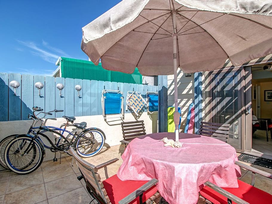 Private gated patio, great place to enjoy a meal, store the included new bikes, or a safe outdoor area for your furry travel companions.
