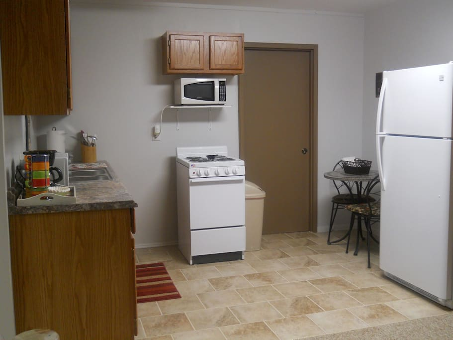 Full sized fridge, small bistro table for eating in.  Microwave