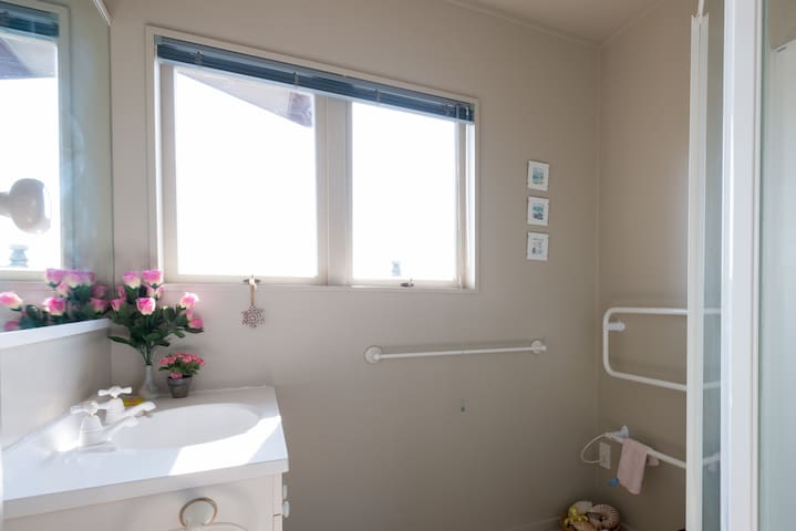 The guest bathroom upstairs has a shower, heated towel rail, extractor fan, hand basin and hairdryer. There is a separate toilet.