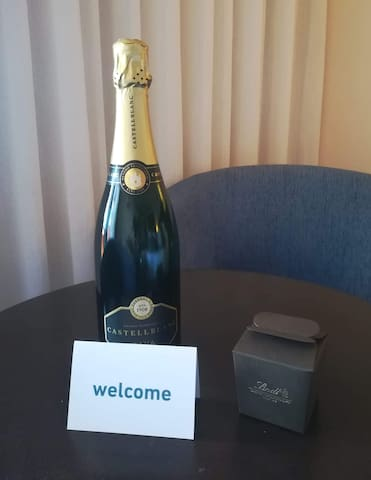 """Welcome to our home with a bottle of Brut Champagne, deluxe mixed nuts bag or chocolate box, coffee capsules, tea bags, still natural mineral water and """"rebuçados"""" (sweets from Portugal).   For little guests... some delicious surprise!"""