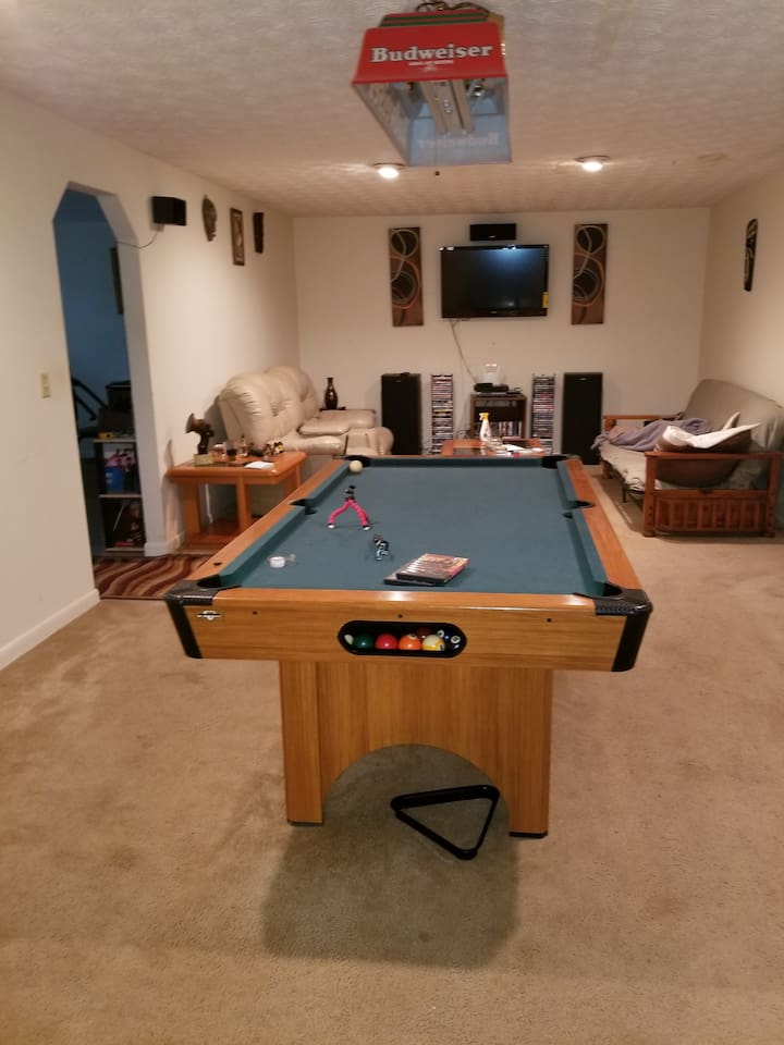 Pool table and living room available for party