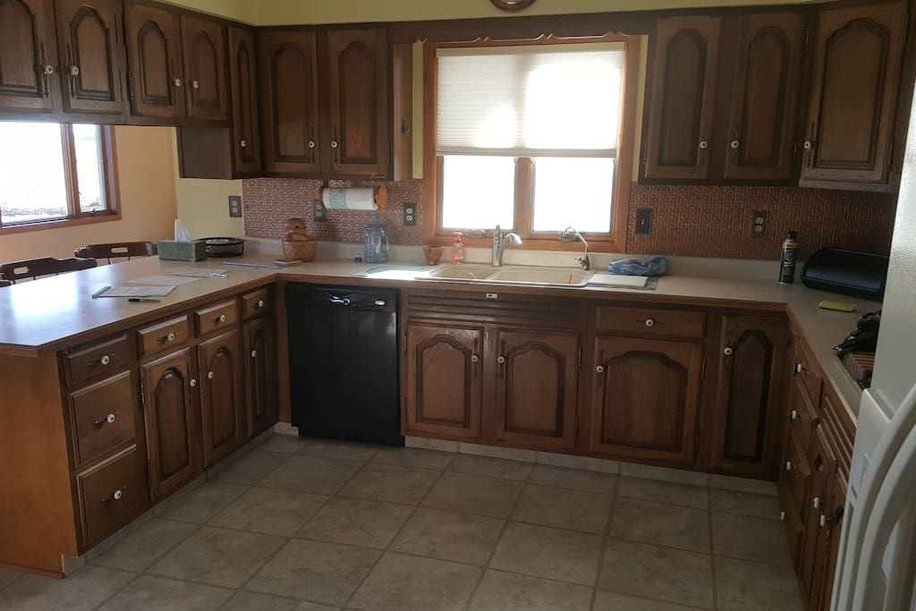 Kitchen w/ oven, microwave, stove, toaster, toaster oven, dishwasher, refrigerator