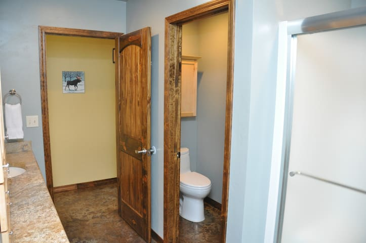 Separate toilet room provides privacy.