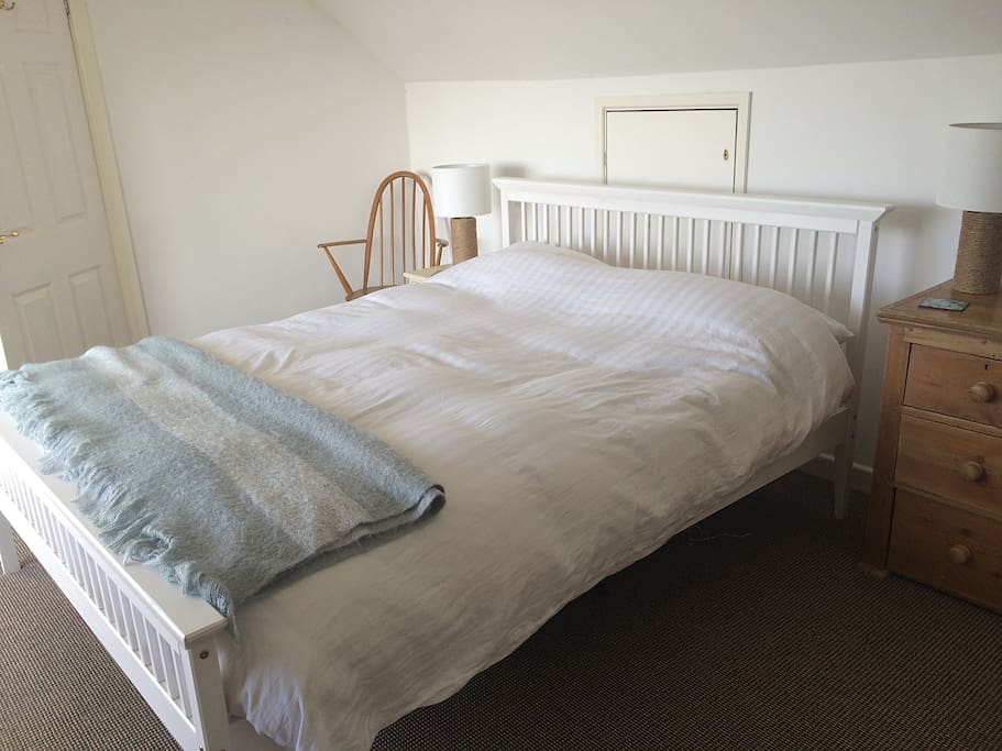 Light filled bedroom one.  See the ocean and beach without leaving the cosy kingsize bed.
