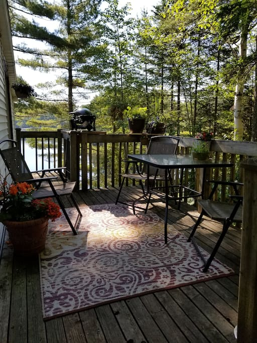 The cabin deck with a great view of the lake and nice and cool nestled in the trees