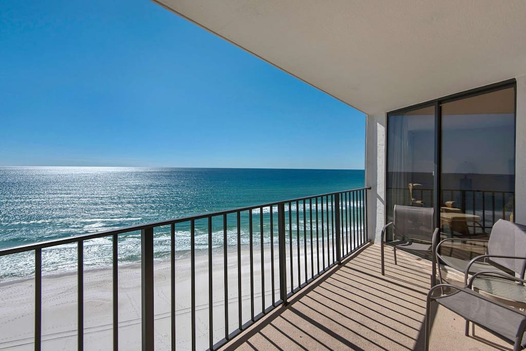 Enjoy the sunset from your beachfront balcony.  Look at that blue water!