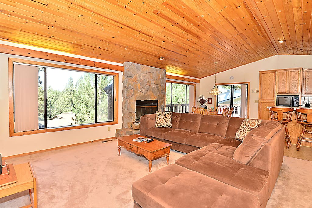 Wood-paneled ceiling, stone fireplace and great views!
