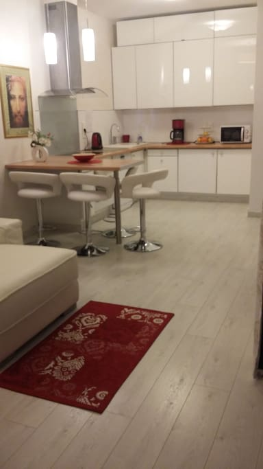 large kitchen and confortable chair