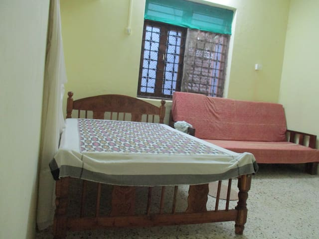 Private bedroom (non-ac) for guest. Single bed and alternatively pull-out couch. Very basic.