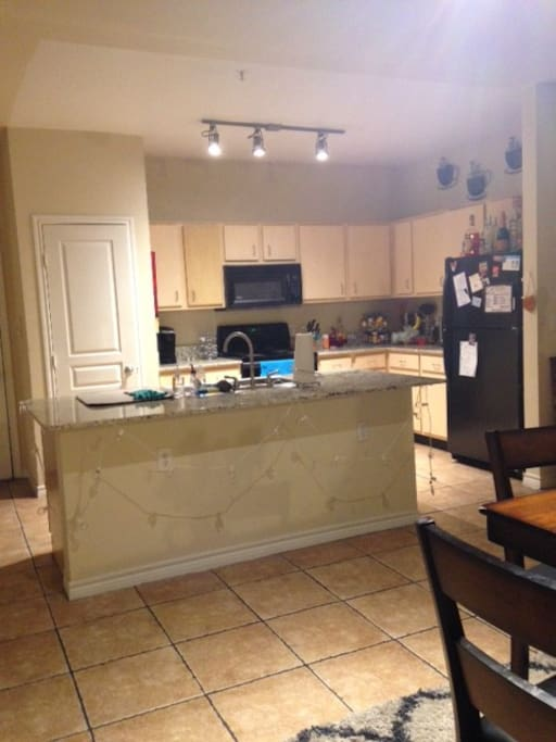 Updated Kitchen with staple appliances and plenty of cooking space