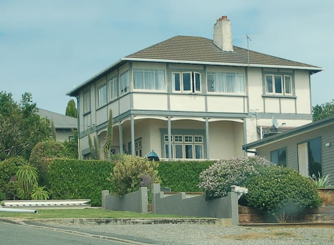 Waterview. The house is about a hundred years old, 2 stories high and surrounded by mature gardens.