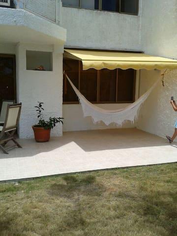 The flat has a nice terrace with a  backyard garden.