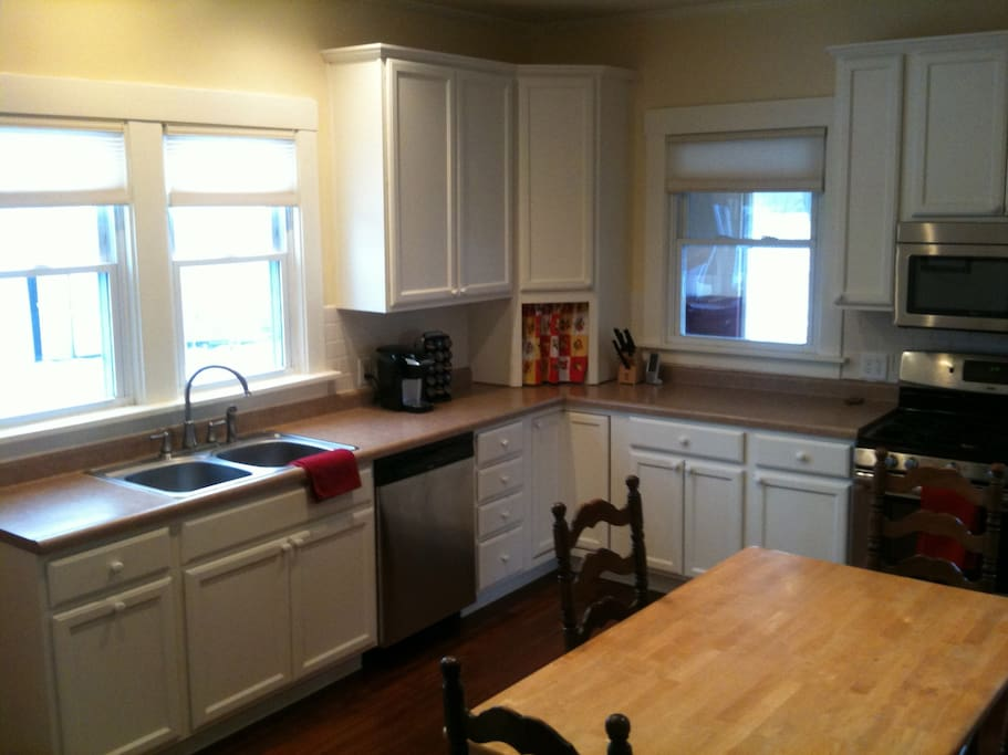 Well-equipped farmhouse kitchen, stainless steel appliances