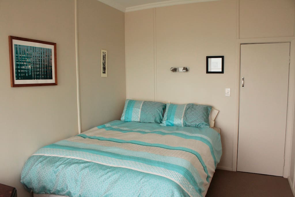 Be lulled asleep by the lapping waves In the front Tasman sea bedroom.