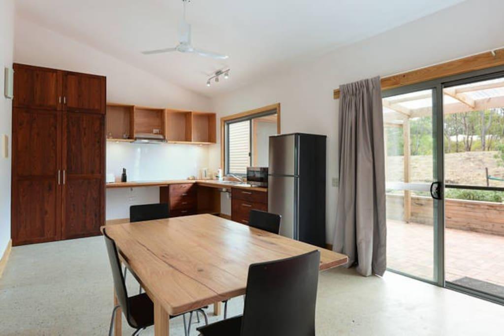 spacious open plan kitchen- dining