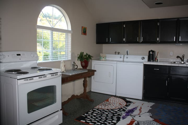 Upstairs kitchen with dishwasher and laundry