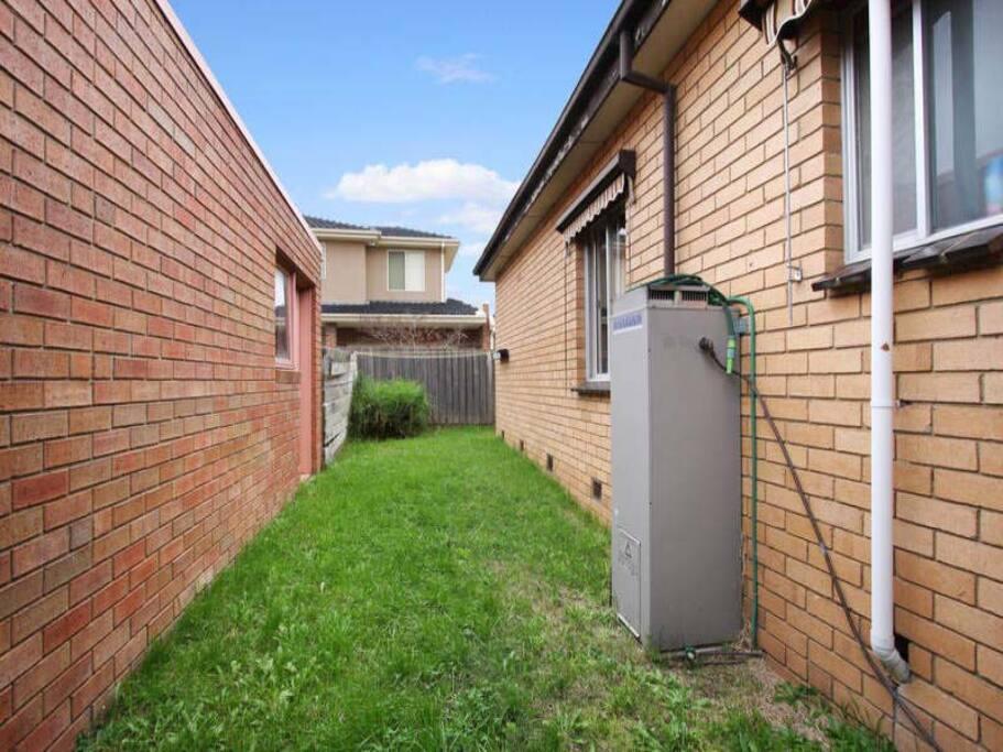 clothes hanging area/backyard/garagarage entrance
