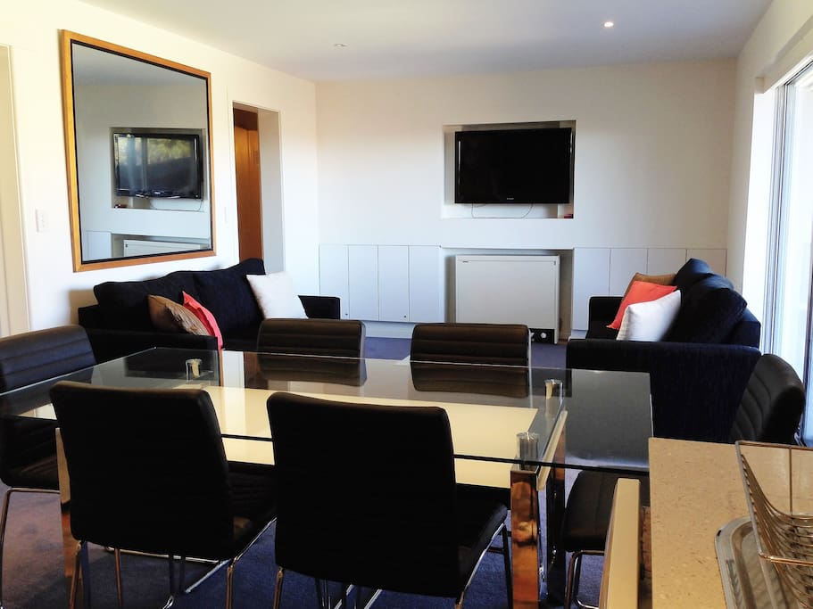 Comfortable, modern  loungeroom with sofa bed, large LCD TV & fabulous views