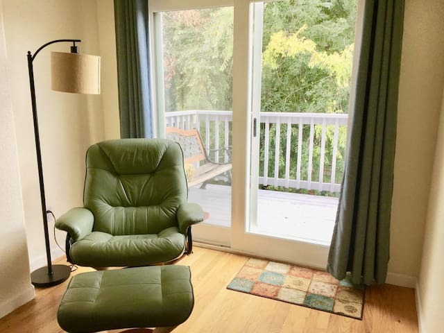 Reading space with tons of natural light in the upstairs loft.