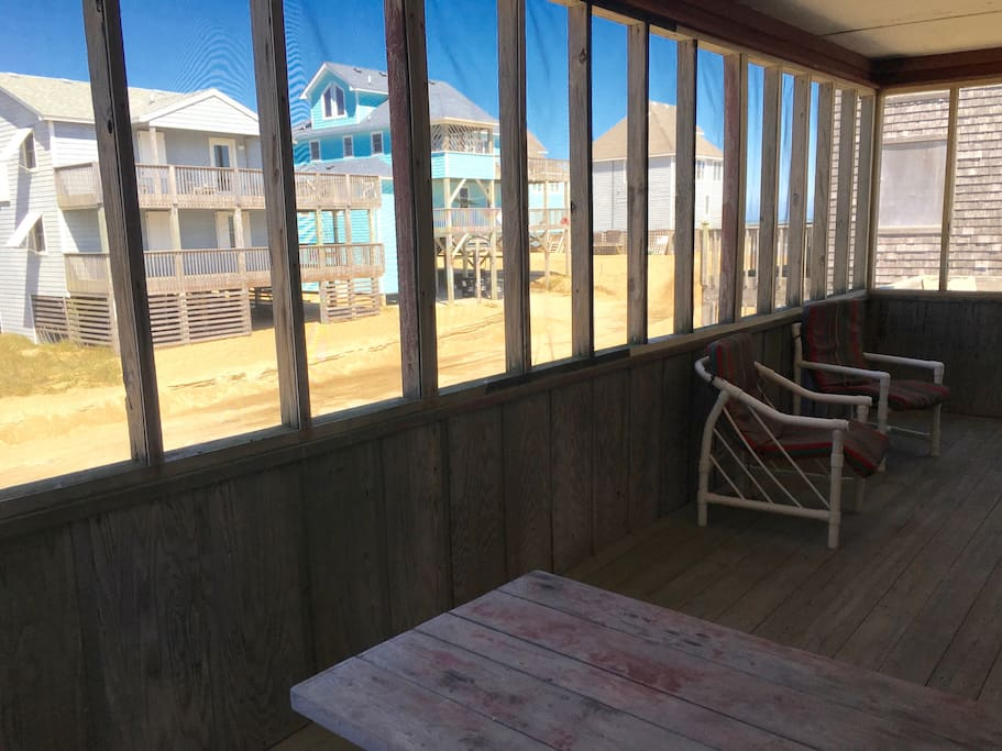 Enjoy the ocean breeze while you relax on the large screened porch.