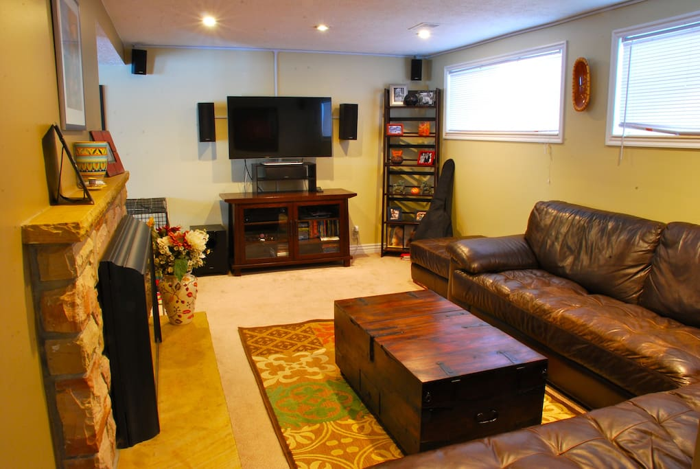Living area with large screen TV, surround sound & cozy fireplace.