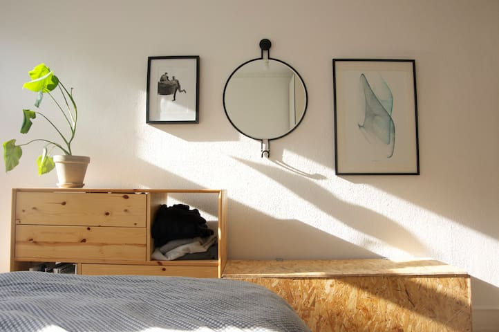 "Bedroom decoration. Right: local artist, two men, Left: ""Drawing Machine"" by Drawing Machine"