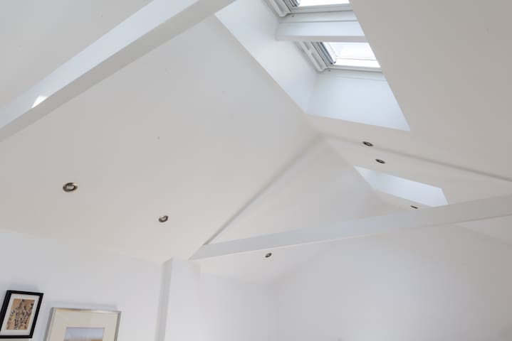 Remote-controlled VELUX roof windows that illuminate more natural light and fresh air for your indoor comfort.