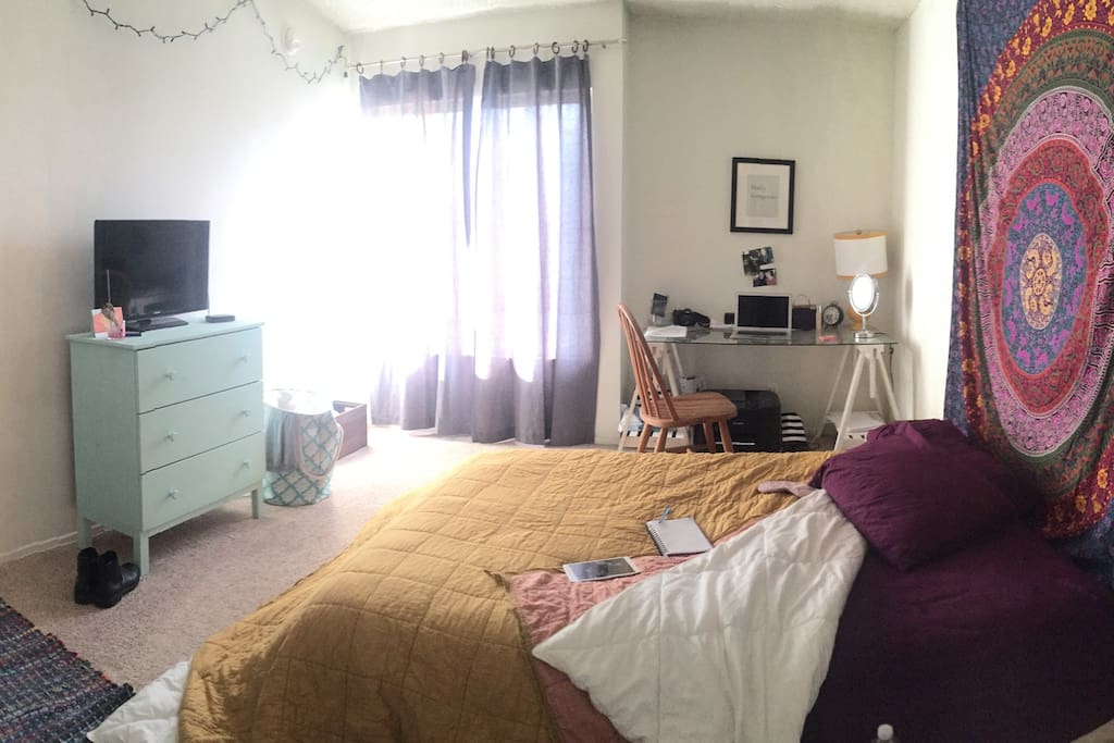 Bedroom is well lit during the day! Large desk to work on. Comfortable bed with clean linen and hippy style decor