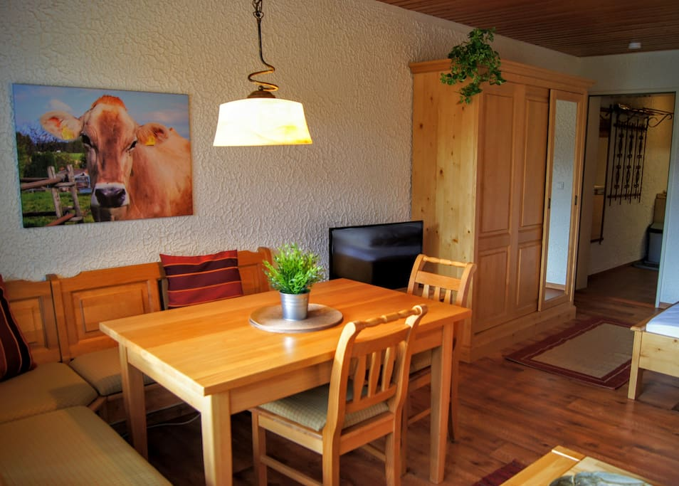 Dining area with corner bench and original photograph on canvas