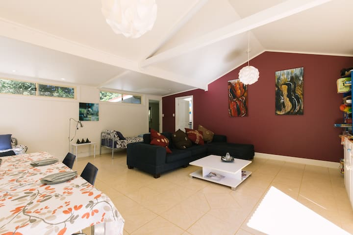 Living room with dining area and 2 single beds