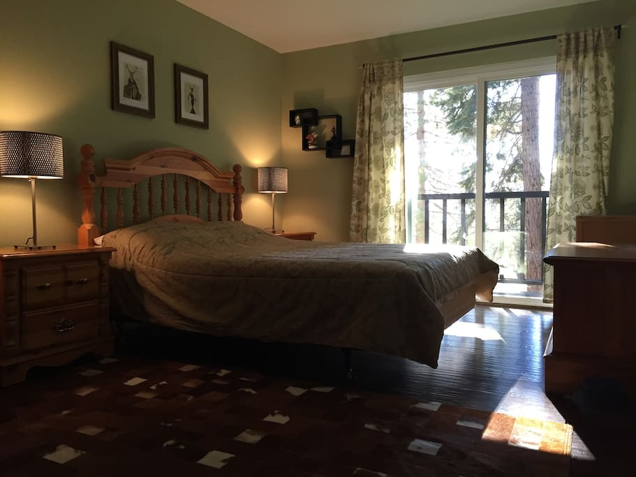 Master bedroom with private balcony, brand new hardwood floors and new paint
