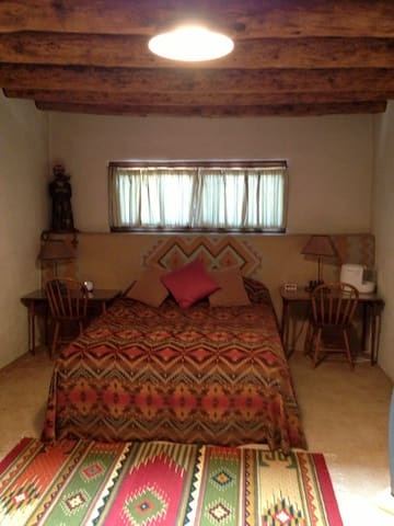 Master bedroom with a shared wall to the little chapel in La Loma Plaza.