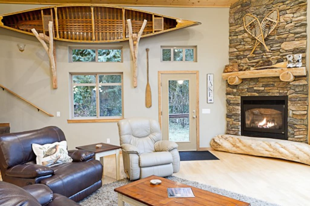 Great room with large gas fireplace and 1927 Canoe